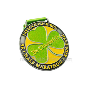 Running game finisher medal with green ribbon