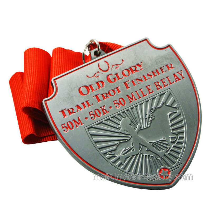 Running race finisher award medal with ribbon